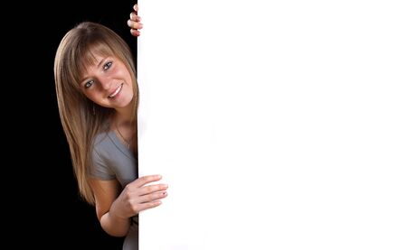 Pretty blonde girl with a blank presentation board  Stock Photo - 9070681
