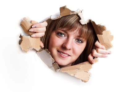 Woman coming out from ripped billboard Stock Photo - 9070693