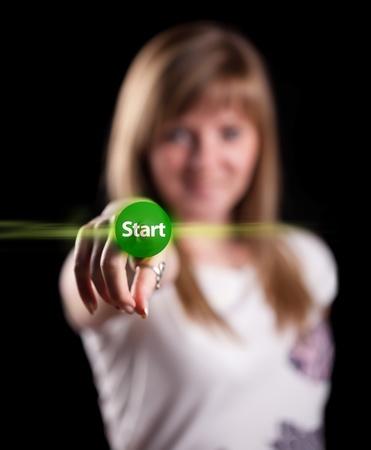 Woman pressing START button, background in bokeh Stock Photo - 9070679