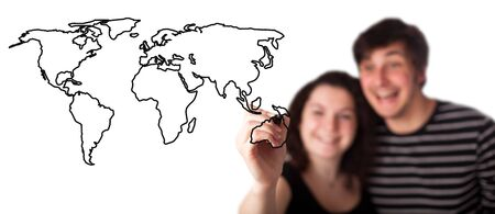 A picture of a young couple drawing a world map over white background Stock Photo - 9114611