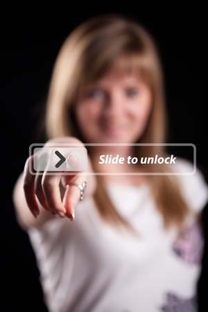 Woman pressing touch screen interface, background in bokeh Stock Photo - 9213719