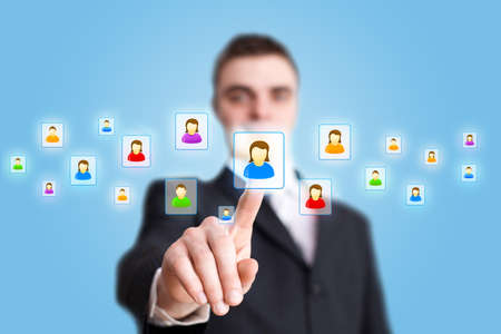 Businessman hand pressing Social network icon photo