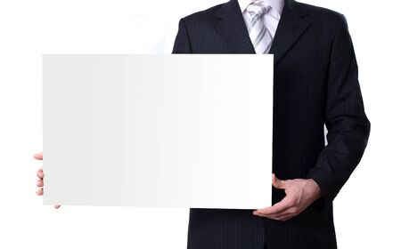 Businessman holding a blank white board photo