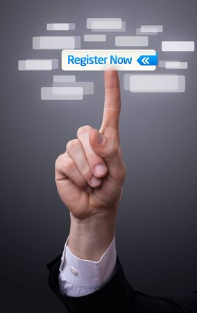 register button: man hand pressing register now button Stock Photo