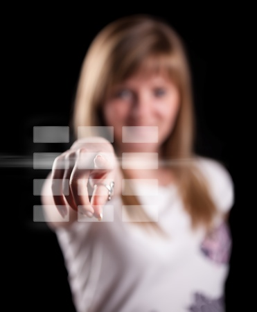 Woman pressing touch screen interface, background in bokeh Stock Photo - 9249001