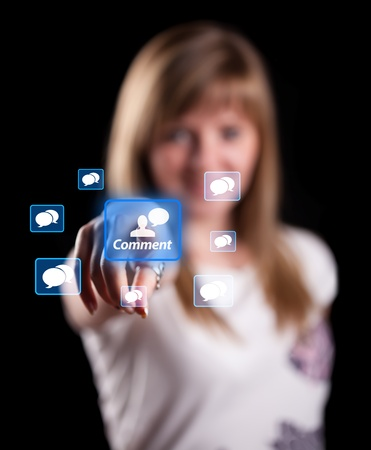 media event: Woman pressing socian network icon, background in bokeh