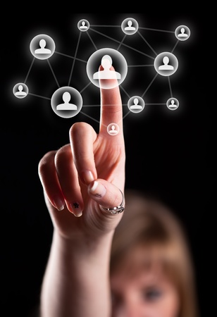 Woman hand pressing social network icon Stock Photo - 9249005