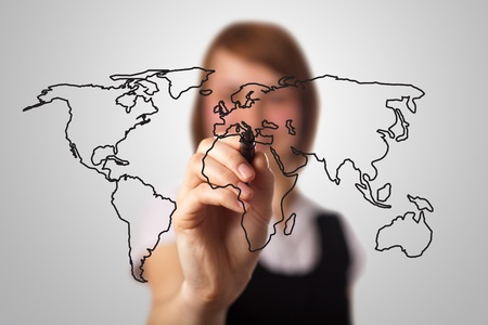 businesswoman drawing the world map in a whiteboard (on bokeh)  photo