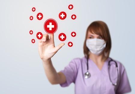 Woman doctor pressing digital button, selective focus, medical theme photo
