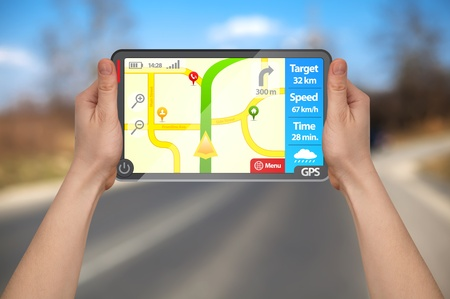 a male hand holding a modern colorful touchpad gps tablet photo