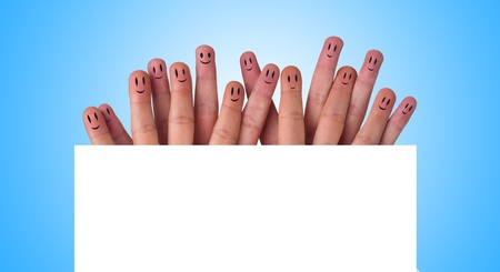 Happy group of finger smileys (holding whiteboard) photo