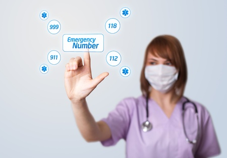 emergency number: Woman doctor pressing digital button, selective focus, Emergency Number