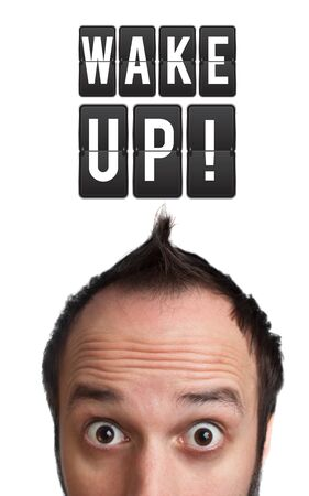 up wake: Funny Young man with wake up sign over head, isolated on white background Stock Photo