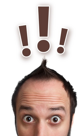 unanswered: Funny young man with exclamation mark over his head, isolated on white background