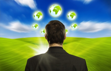 Young businessman with ECO icons floating around his head photo