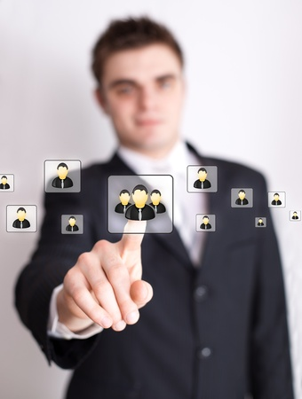 Businessman hand pressing Social network icon  Stock Photo - 9289277
