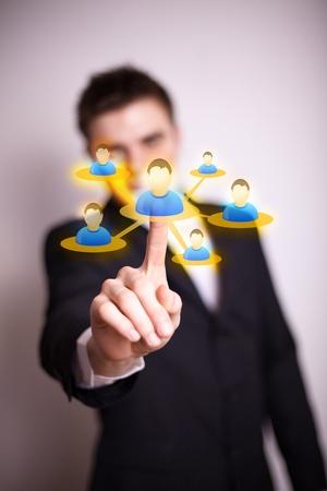 Businessman  hand pressing Social network icon Stock Photo - 9289287