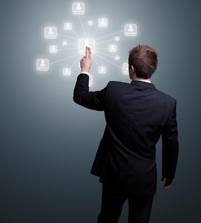 pressing: Businessman  hand pressing Social network icon