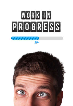 Young man with Work in progress mark over his head , isolated on white background  photo