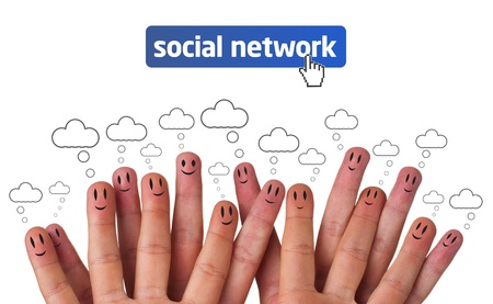 Happy group of finger smileys as social network with speech bubbles photo