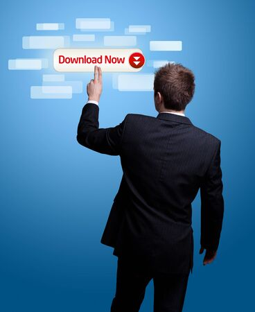 Businessman hand pressing download now button photo