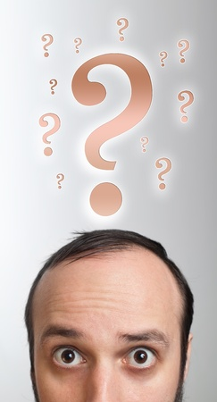Young white Caucasian male adult has way too many questions in his head Stock Photo - 9342289
