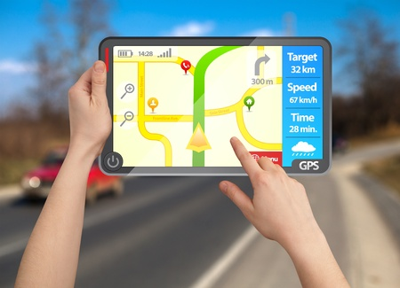 car navigation: a male hand holding a modern colorful touchpad gps tablet Stock Photo