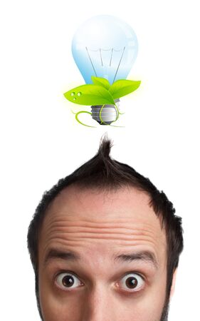 Funny young man with light  bulb over his head, isolated on white background photo