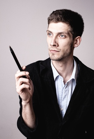 Man thinking about a solution with a pencil photo