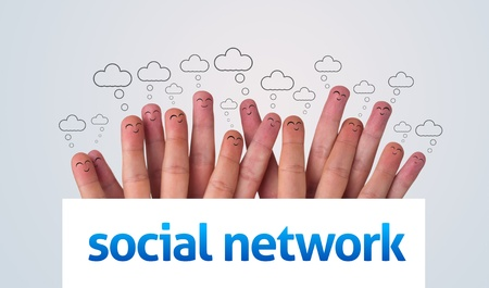 Happy group of finger smileys holding whiteboard with social network sign Stock Photo - 9342306