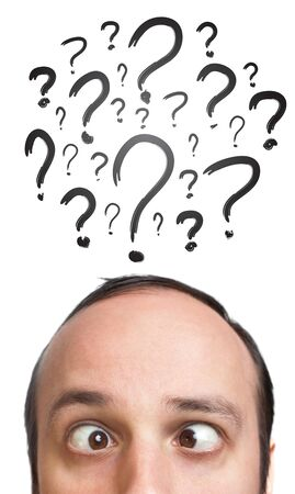 Young white Caucasian male adult has way too many questions in his head, isolated on white background Stock Photo - 9361922