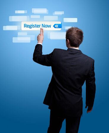 future advertising: Businessman hand pressing register now button. Stock Photo