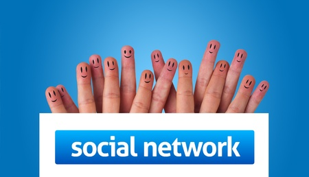 social work: Happy group of finger smileys holding whiteboard with social network sign Stock Photo