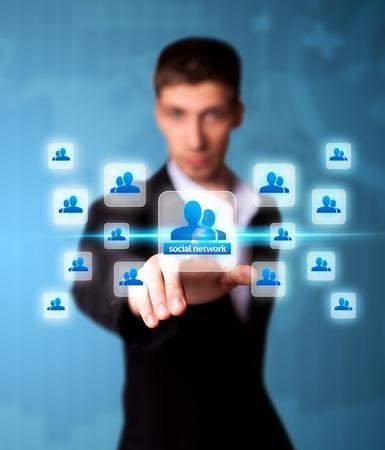 press media: Man pressing social network icon, futuristic technology