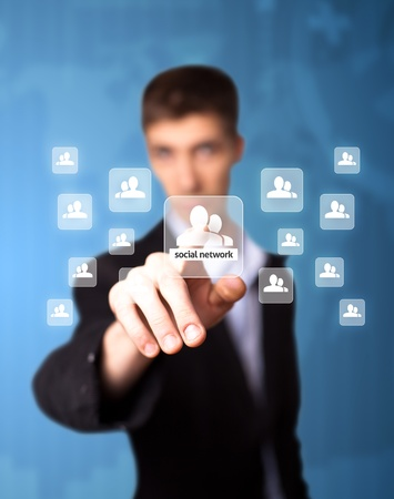 Man pressing social network icon, futuristic technology photo