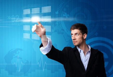 touchscreen: Un hombre de negocios que trabajan en la tecnolog�a moderna Foto de archivo