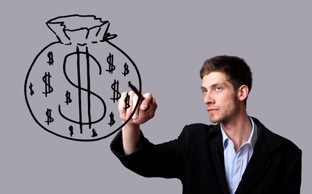 Businessman hand drawing and idea for making money on the whiteboard photo