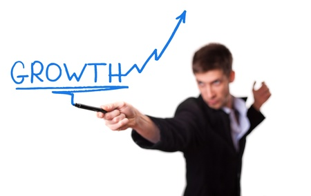 Businessman drawing a rising arrow, representing business growth (selective focus) photo