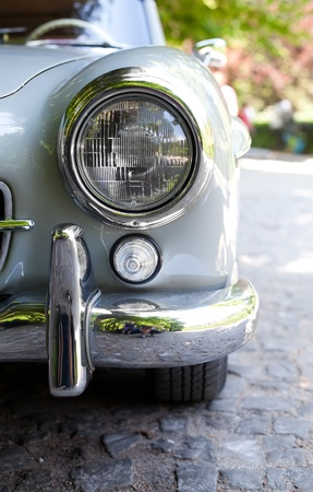front bumper: Close up photo of headlight retro car