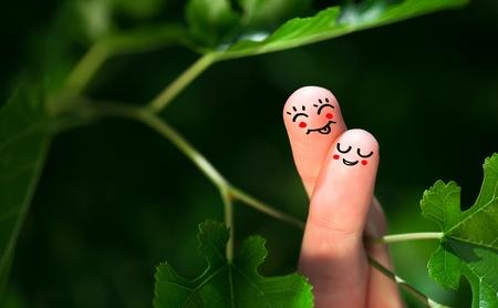 Hugging finger smileys in nature. photo