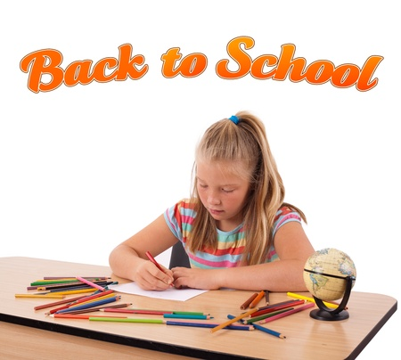 Young girl drawing on desk with back to school theme isolated on white photo