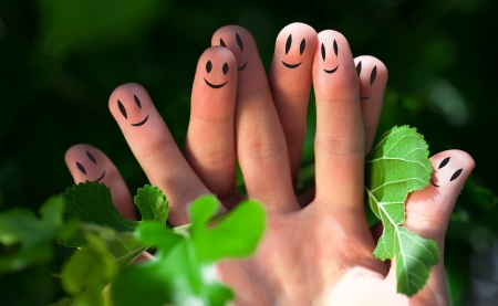 Happy group of finger smileys in nature photo