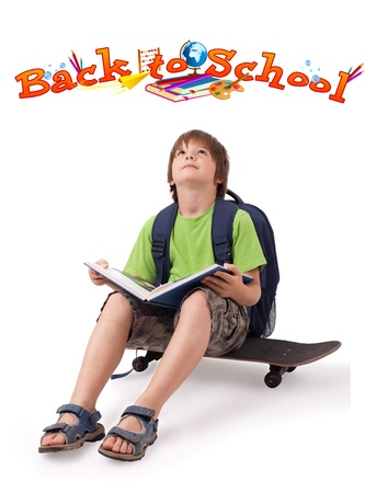 Kid with skateboard and books with back to school theme isolated on white photo