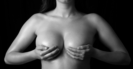 close up, topless woman body covering her breast with hand 2, B&W Stock Photo - 10203948