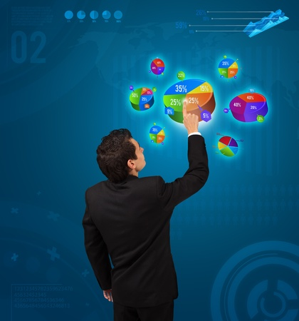 Businessman pressing pie chart button, futuristic technology photo