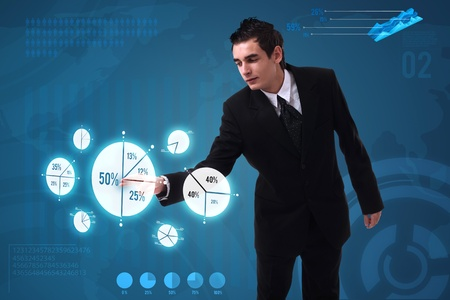 Businessman pressing pie chart button, futuristic technology Stock Photo - 10232556