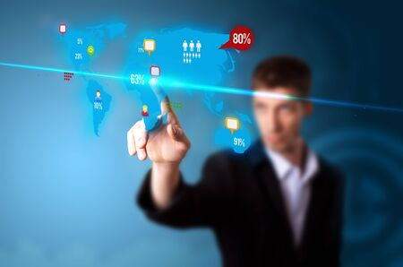 web marketing: Businessman pressing social media button on digital map, futuristic technology Stock Photo