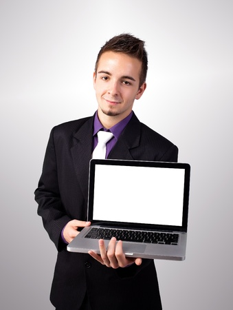 Young man showing a work presentation on the laptop photo