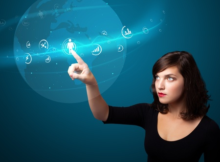business event: Businesswoman pressing modern social buttons on a virtual background Stock Photo