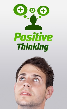 negative thinking: Young persons head looking with gesture at positive negative signs